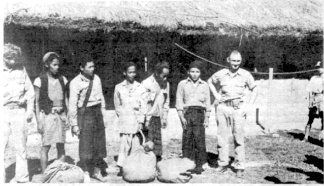 Two rescued Hump crewmen stand with their five rescuers after being forced down in India's rugged Naga Hills. The Naga tribesmen (center) led the two men of the 3rd Squadron, 1st Transport Group, Air Service Command, back to civilization. Left to right: Pvt 1st Class Harvey Sisson of Dorchester, Massachusetts, Wah Bon, Silong Nang. Shoed Nang, Joe de Bull No, Silong La, and Lt. Gerald M. Jernigan of Manchester, Tennessee, pilot of the plane. It was a good Christmas homecoming away from home in 1943. (10th Army Air Force Combat Camera Unit.)