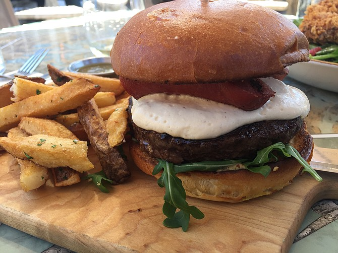 The Spoon Burger, topped with beer cheese and grilled bratwurst