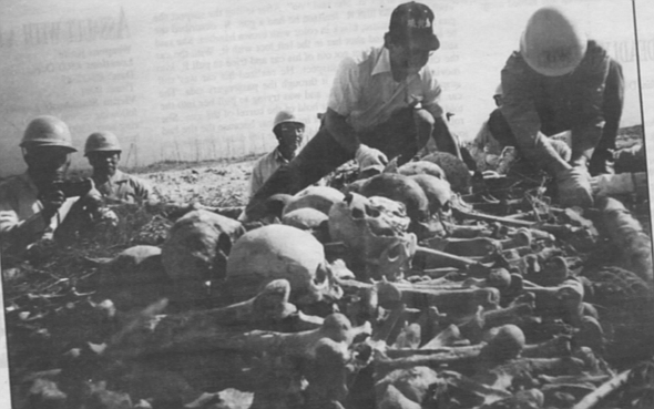 Workers prepare newly discovered Japanese remains for cremation. Iwo Jima was the killing ground for 28,000 human beings, including the entire Japanese garrison and 6800 U.S. Marines.