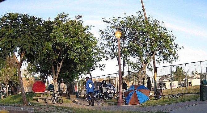 Nancy Palmer says she has befriended many homeless people, but she hesitates to let her kids walk alone near the park.