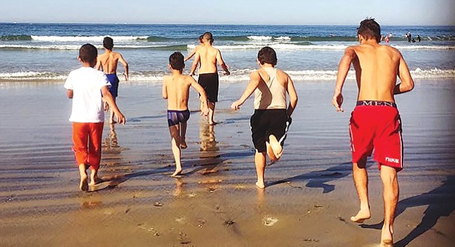 Refugee children on their first ever beach outing. The scene is deceiving, says Kristin Burke: What El Cajon-based refugees have compares poorly to what's available to Atlanta refugees. - Image by Kristin Burke