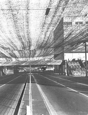 Pacific Highway with canopy. The city ordered air-raid drills and frequent blackouts and camouflaged the aircraft industries with netting and dummy trees on the rooftops and roads.