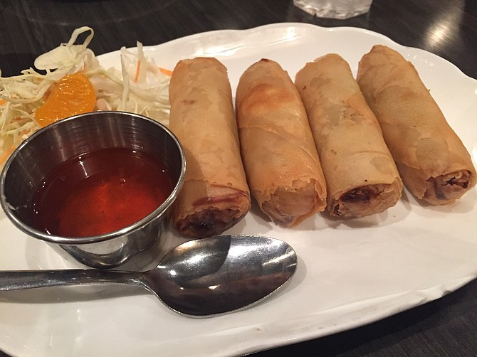 The Yummy Sticks, fried veggie egg rolls served with a plum sauce. Careful, they arrive lava hot.