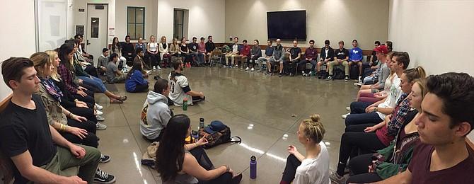 Delta Beta Tau the co-ed service fraternity meditating.