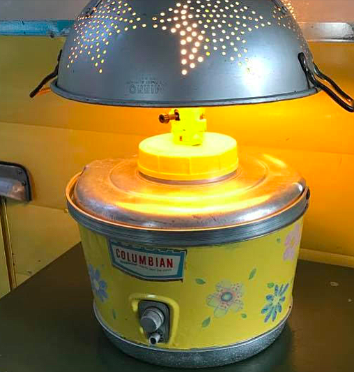 The matching yellow Columbian water jug that was transformed into a lamp.