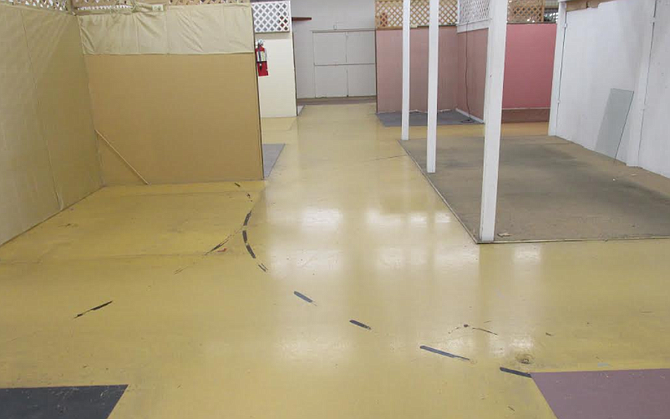 The old, polished concrete floor is still widely visible in the building.