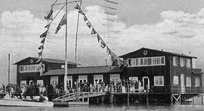 """San Diego Yacht Club, 1935. At first, the clubhouse was """"situated over water and required trekking over mud for access."""""""