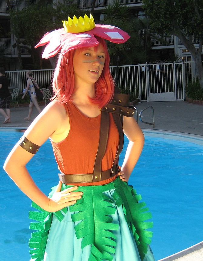 cosplayer in front of the pool
