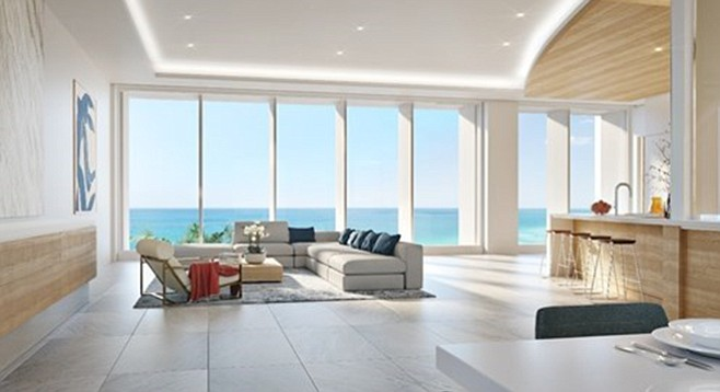 Slider window walls open the residence to the ocean.