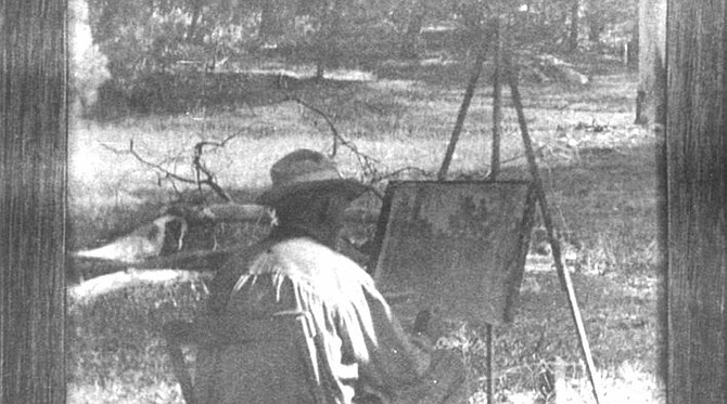 "Charles Fries painting at Camp Merritt, Laguna Mountains, 1924. ""We made a number of trips up to Laguna Mountain. Mr. Merritt had built a cabin up there, which was more pleasant than camping out."""