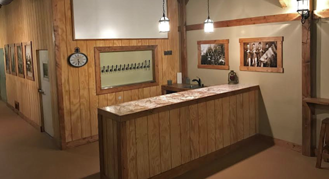 Civil war photos and rustic wood trim decorate Ramona's new Smoking Cannon Brewery.