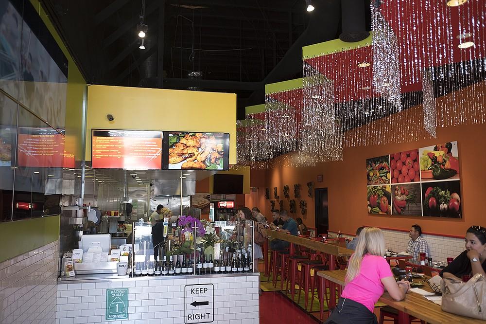 Colorful décor, including a floor painted like a Mondrian block-art tableau