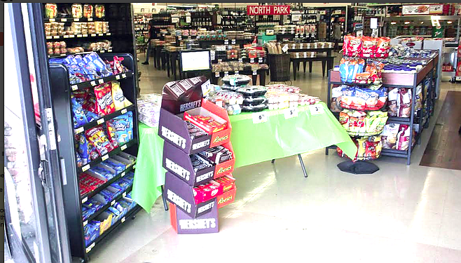 The Smart & Final aisle that leads directly to the liquor department had been blocked by a table of snacks.