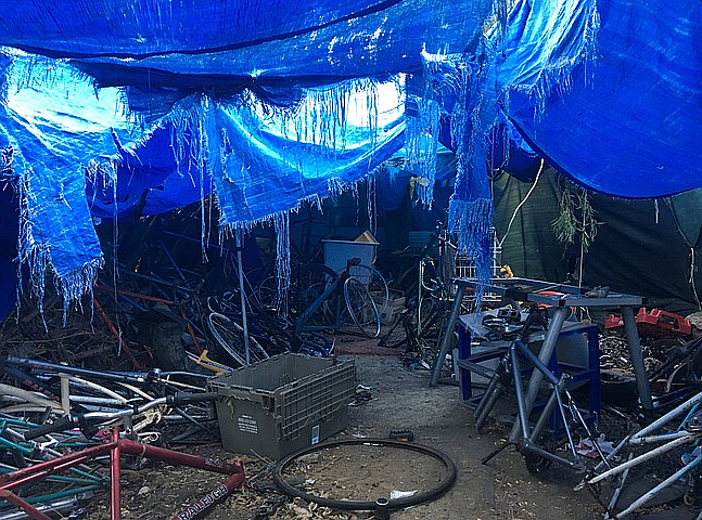 Homeless camp with hundreds of stripped down bicycles discovered along the San Diego River last week.