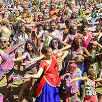 Lots of yoga, lots of dust at the Holi Festival