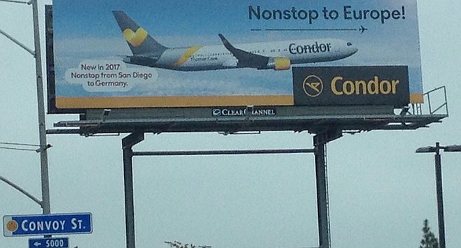 Billboard on Convoy St. A one-week trip to Frankfurt, booked two weeks in advance, would run $619.98.