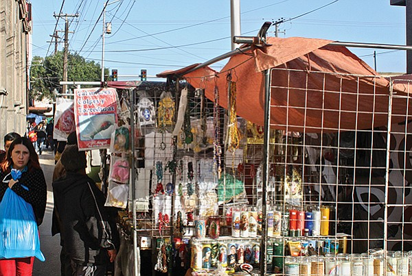 Confined stands of religious trinkets and improvised sobadores (masseurs)