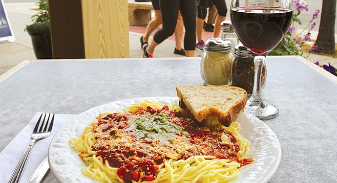 """Island Pasta. """"We own this little piece of land beside the sidewalk. And the magic thing is it curves away from Highway 75."""""""