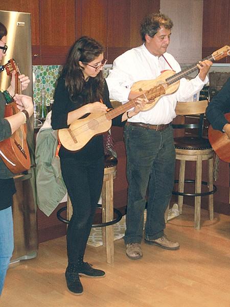 Teresita de la Torre strums the jarana while playing son jarocho music from Veracruz.