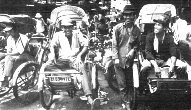 "Rickshaws. The kid in ragged shorts and thongs who pedals me: ""Hang ten, man! I be your groovy cycloman. I hate Communist. VC they kill my father."""