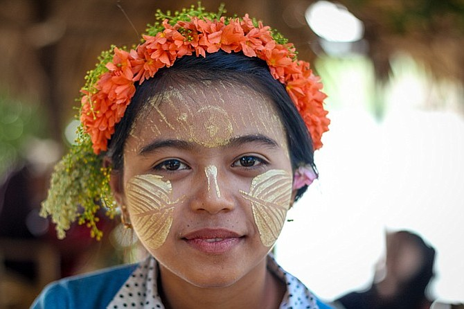 Burmese girl with thanaka, a commonly used skin care product.