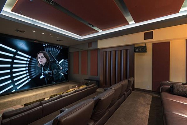 Acoustically engineered theater with Crestron home automation