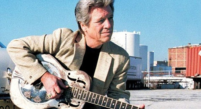 Somehow John Hammond and his big sound are going       to fit in Sweetwater High