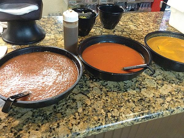 The salsas, made here: verde, roja, naranja.