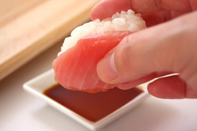 Japanese often eat sushi barehanded, not with chopsticks