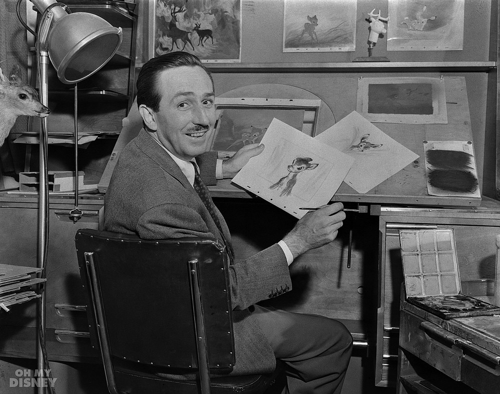 Walt Disney showing sketches from Bambi.