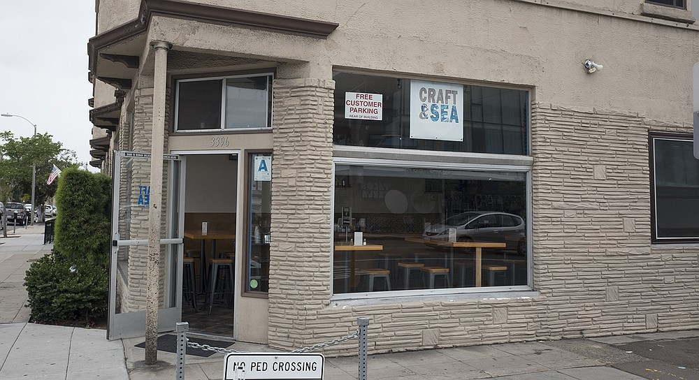 A small window sign marks the location of Craft & Sea
