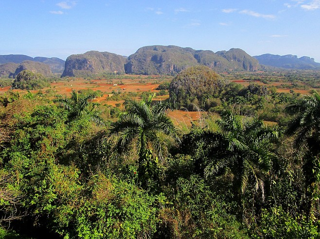 Viñales Valley. Its steep-sided limestone hills are known as mogotes.
