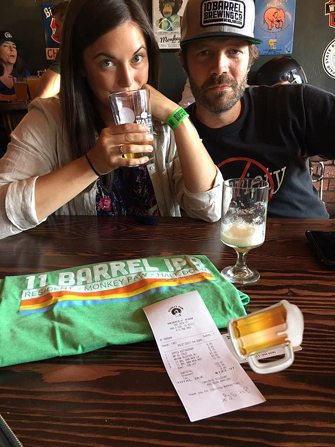 In response to a Facebook-issued challenge, 10 Barrel brewer Ben Shirley patronizes Monkey Paw to buy beer and a t-shirt with a company credit card.