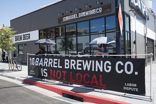 San Diego's Local 1506 carpenter's union is picketing 10 Barrel for not hiring local contractors to build its multi-million dollar brewpub.