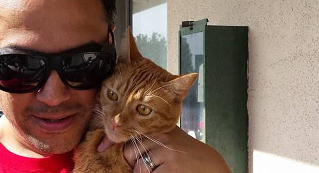 Adrian Ernesto Cepeda and cat