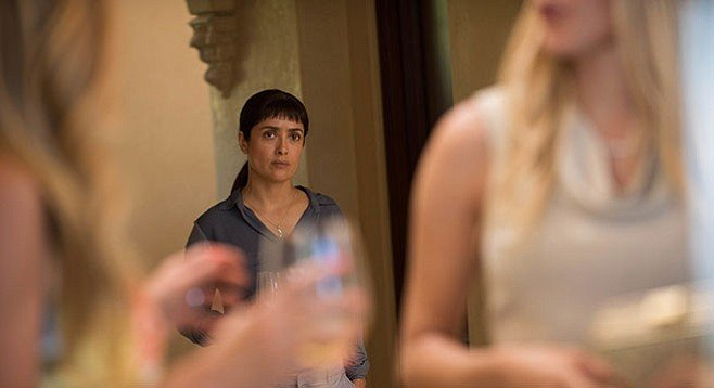 Beatriz at Dinner: Beatriz (Salma Hayek) and her bangs transition from unplanned guest to displeased dinner companion in Miguel Arteta's drama.