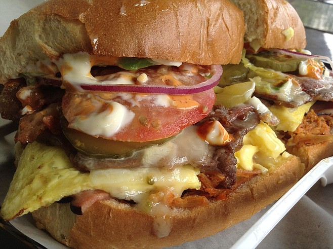 Big slab of egg with pepper jack gives the torta a breakfast flavor.