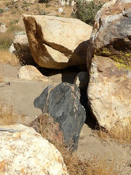 The dark canyon rocks are hornblende biotite