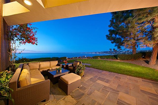 """Potential buyers can """"entertain in style in your spacious oceanfront yard with large grassy area."""""""