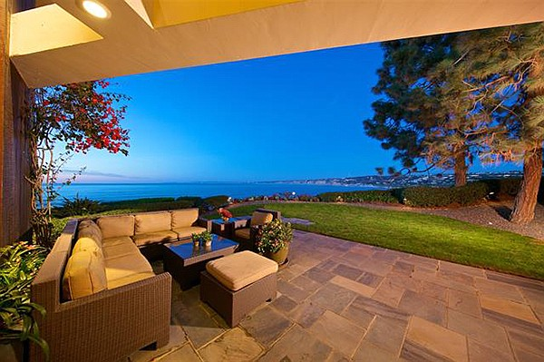 "Potential buyers can ""entertain in style in your spacious oceanfront yard with large grassy area."""