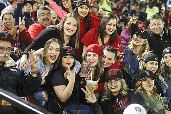 """Why watch the dismal Padres when """"five tickets in the front row behind the visitors' dugout costs $32"""" at a Toros de Tijuana game."""