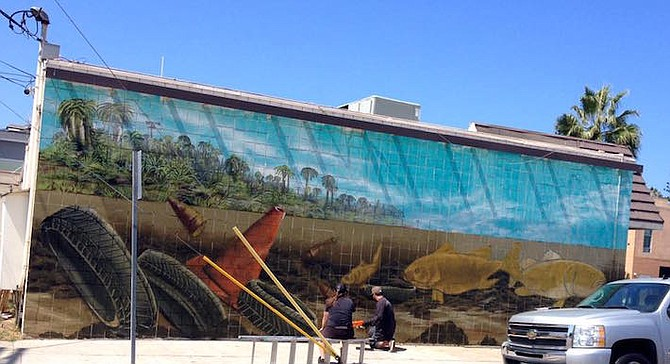 Hebets putting final touches on mural - Image by Mitchell McKay