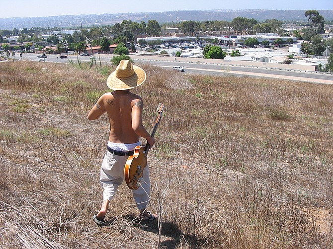 Taken At where Flight was held.  History of Aviation.  Backdrop Mexico.  Taken By Anthony Arellano.  Ant Walking Down with Bass Guitar.  For Promo Shot 2006.  Date 8-5-06.  11:32 am.