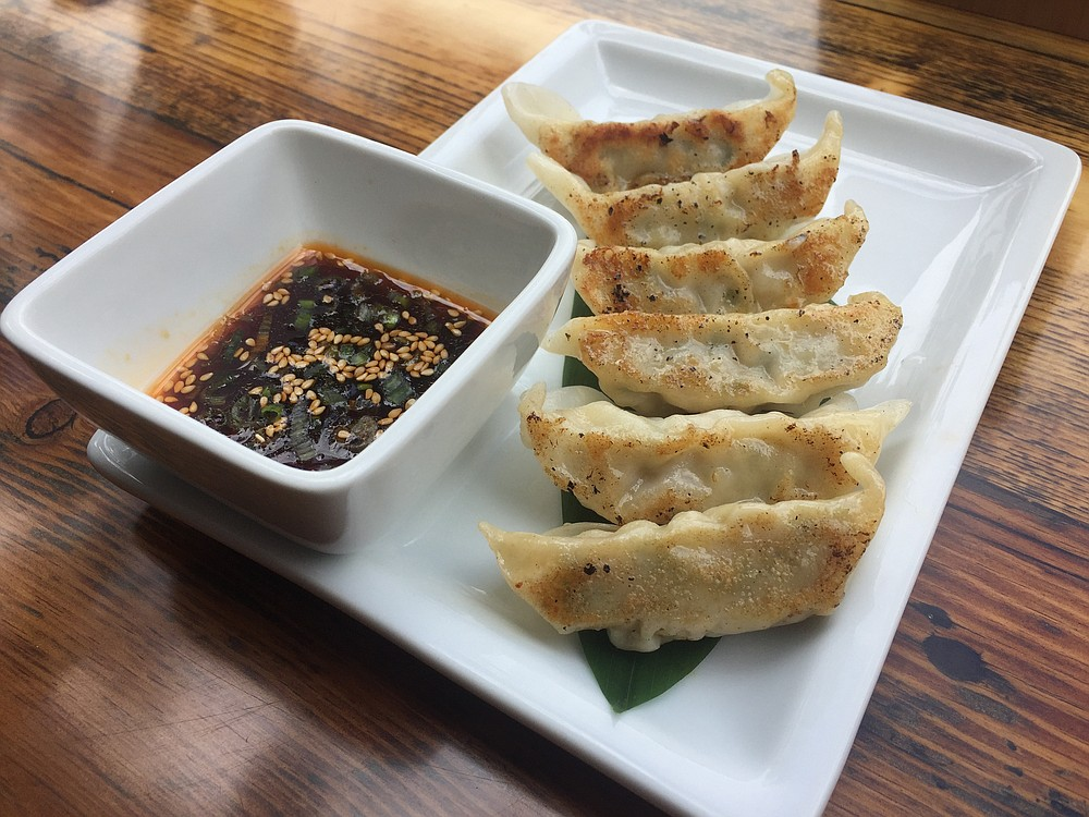 Pork and vegetable gyoza, with  chili-sesame ponzu sauce.