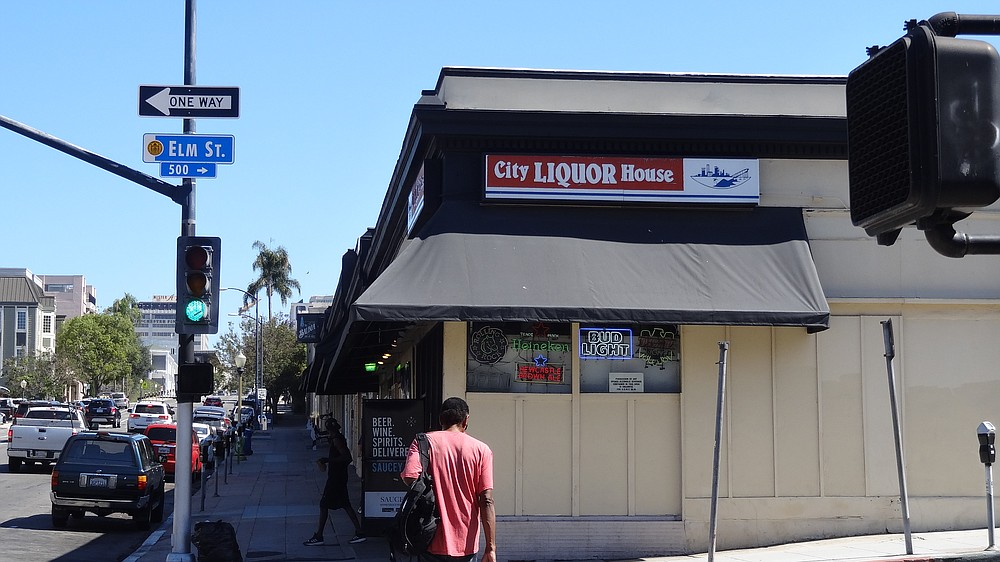 David Somo, manager of City Liquor House, said CVS can easily undercut his prices on liquor and groceries.