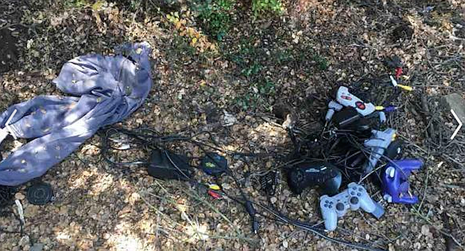There was charred wood and other burnt remnants, an abandoned tent, a bunch of trash — and Nintendo and Sega Genesis video game controllers
