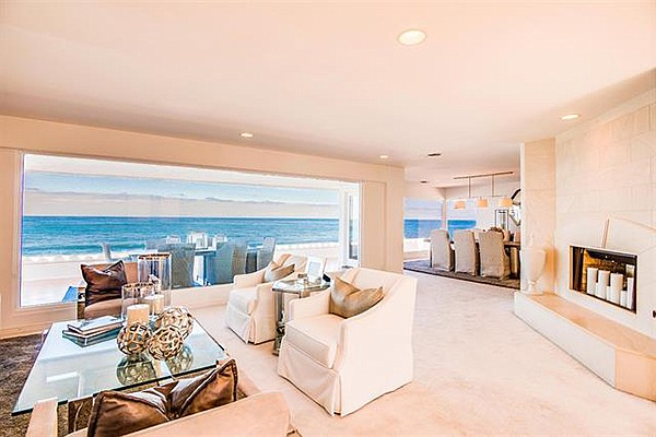 Living room. The owner is willing to throw in the furnishings and a Rolls Royce convertible with the right offer.