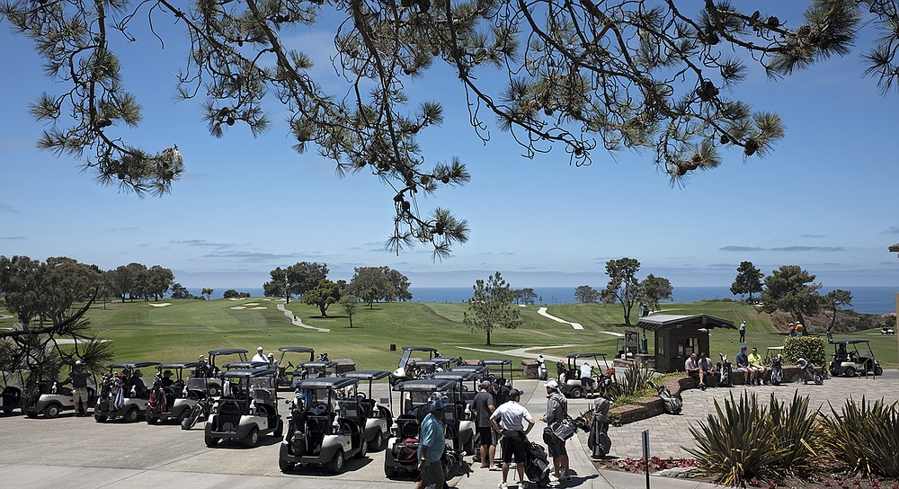The view from The Grill at Torrey Pines deck includes golf carts