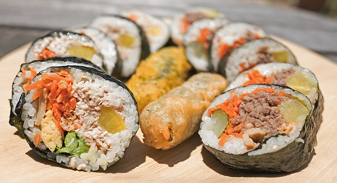 Tuna kimbap and bulgogi kimbap, with fried seaweed and glass noodle rolls in the center