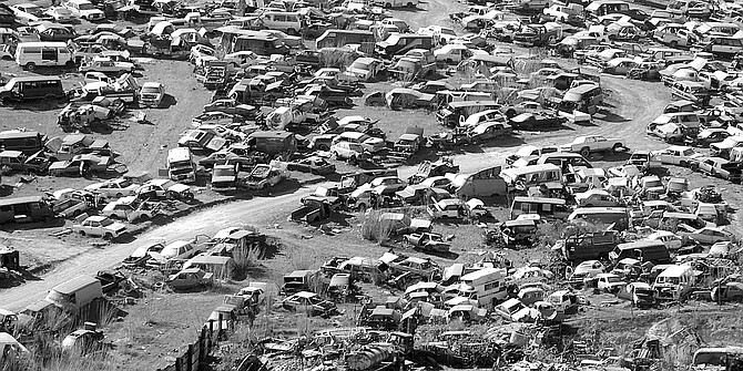 Cars sit in huge yards on the periphery of the city — near the Rodriguez dam and in  La Gloria. - Image by Joe Klein